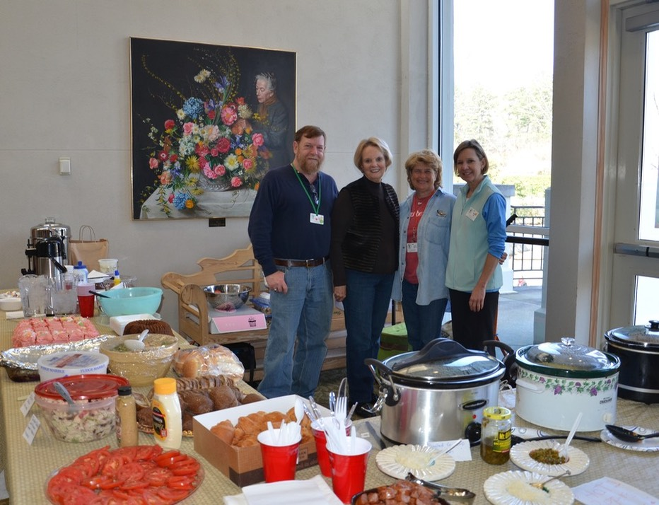A photo of volunteers preparing lunch for the intern class