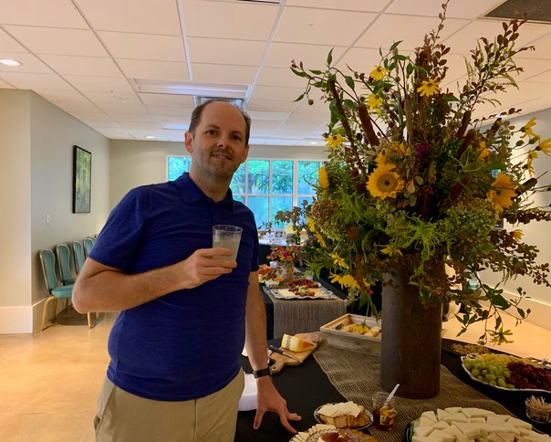 Jason beside the flower arrangement